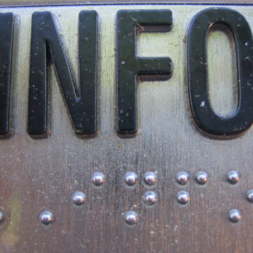 Image by Bobafred: the word INFO and braille beneath it